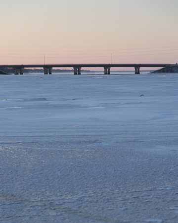 After sunset view of the Hwy 41 bridge and a frozen Fox River and Lake Butte des Morts.