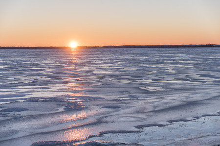 Sunset over a frozen Lake Butte des Morts.  Photographed from the dock at the boat launch in the Town of Butte des Morts.