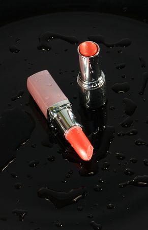 Two lipsticks on Black Mirror photo