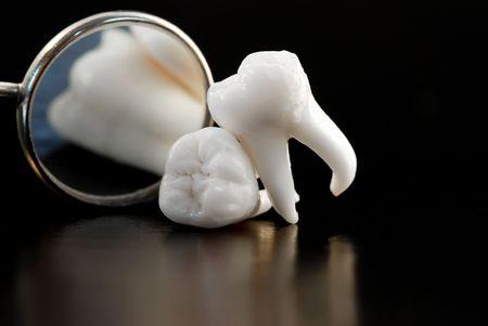 tooth: Real Human Wisdom teeth and Dental Mirror Stock Photo