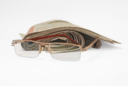 old newspapers and glasses Stock Photo - 5886674