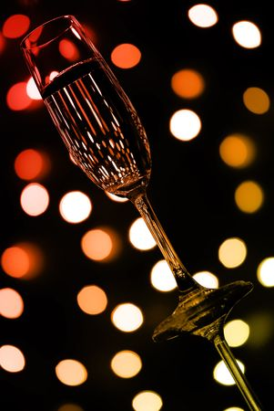 abstract composition: colored champagne glass over lights background Stock Photo - 6261230
