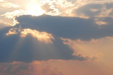 A dark, sunset sky, with sun rays Stock Photo - 6319818
