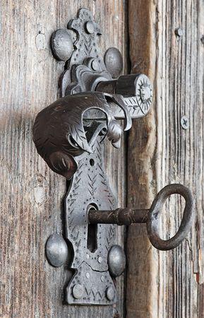 old metal handle at wooden door photo