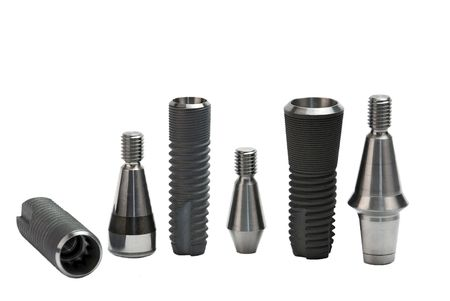 Models of dental titanium implants photo