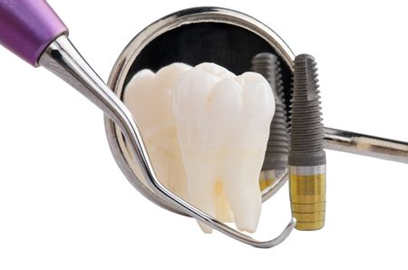 Human tooth, titanium implant and dental tools