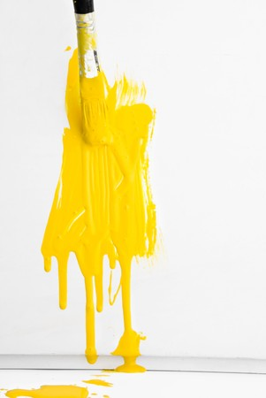Painting the wall with yellow paint and old used brush Stock Photo - 7055987