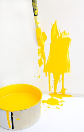 yellow paint and old used brush shallow dept of field Stock Photo - 7055985