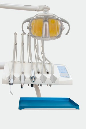 Dental working place. Tools on tray and lamp over white Stock Photo - 7253007