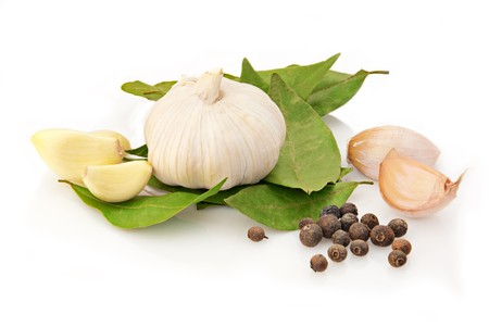 Fresh garlic with laurel and pepper over white background Stock Photo - 7443378