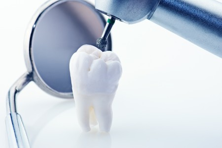 Healthy teeth concept. Real human wisdom tooth dental mirror and machine with drill. Blue tinted image Stock Photo - 7716714