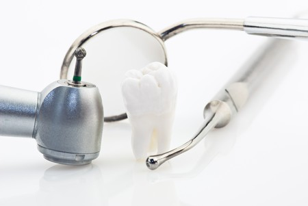 dental tools: Healthy teeth concept. Real human wisdom tooth and dental tools Stock Photo