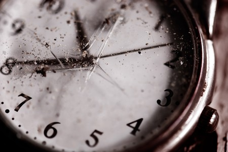 Broken time concept. Old dusty pocket clock with broken glass. Shallow depth of field. Special purple tinted image photo