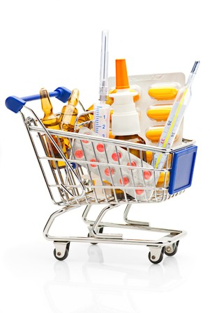 Pharmacy shopping cart full with different medical supplies Stock Photo - 8037344