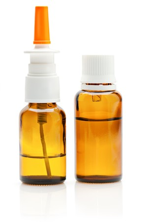 Bottles of nasal spray and drops on white background photo