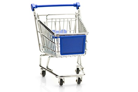 empty shopping cart: Empty shopping cart over white background. SDOF Stock Photo