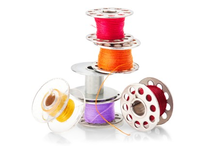 Colored bobbins for machine sewing photo