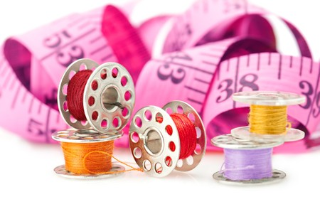 Colored bobbins for machine sewing