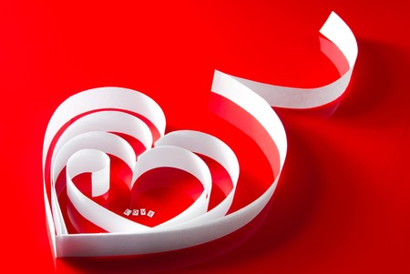 White paper ribbon heart with letters  photo