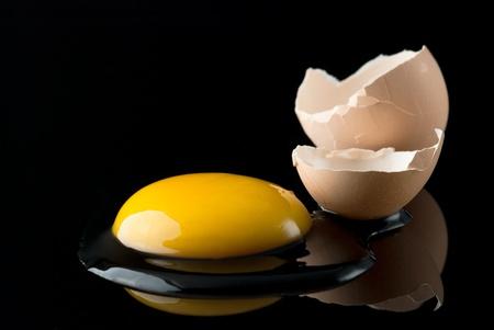 Broken egg on black