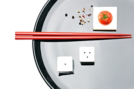 Asian Food Composition. Chopsticks, cherry tomato, salt & pepper, and white tofu cheese on plate Stock Photo - 8272830