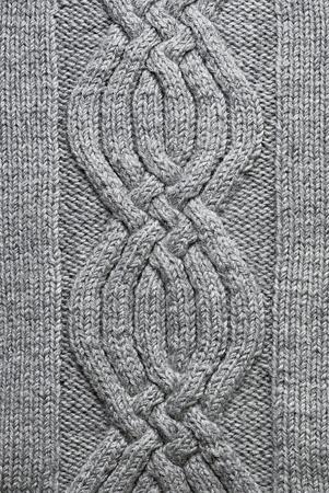 tejidos de punto: Grey circulares de fondo del patr�n de lana hechas a mano Foto de archivo