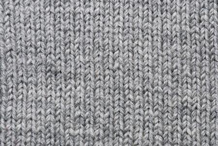 Grey knitting background of handmade woolen pattern photo