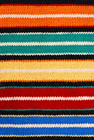 Multicolored knitting background of handmade woolen pattern photo