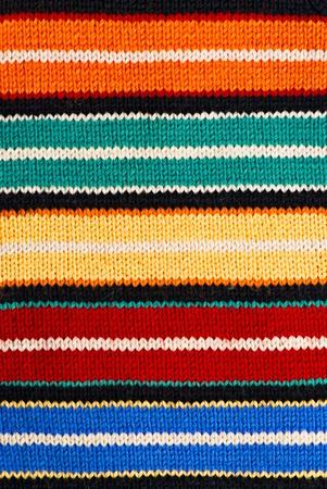 Multicolored knitting background of handmade woolen pattern photo