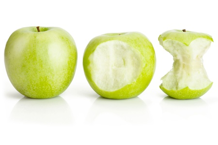 One whole and two bited green apples fruit on white photo