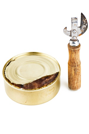 can opener: Old dirty tin can opener with wooden handle and opened tin can with food on white background