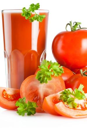 Tomato juice and parsley. Ripe tomatoes, glass of tomato juice and fresh parsley on white background. Sdof photo