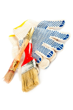 Set for home renovation. Paintbrushes and gloves. Shallow dept of field Stock Photo - 8770459
