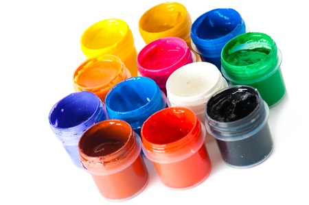 paintbox: Set of used multicolored watercolor paint in opened containers on white background. SDOF Stock Photo