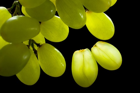 Macro green grapes isolated on black background photo