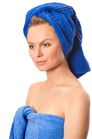 Portrait of young beautiful woman after bath with blue towel on her head isolated on white background Stock Photo - 9249919