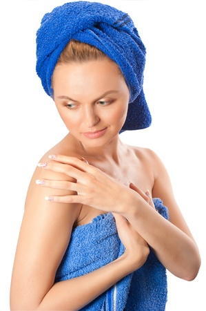 after the bath: Portrait of young beautiful woman after bath with blue towel on her head isolated on white background Stock Photo