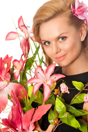 Portrait of young beautiful woman holding flowers isolated on white background photo