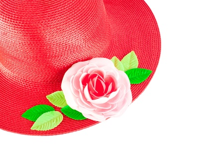 cropping: Red straw woman`s summer hat with roses isolated on white background. Cropping for text copyspace