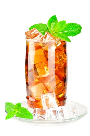 Glass of iced tea with ice cubes and mint on white background photo