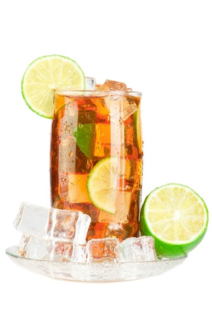 Glass of iced tea with ice cubes, lime and mint, covered with water drops on white background photo