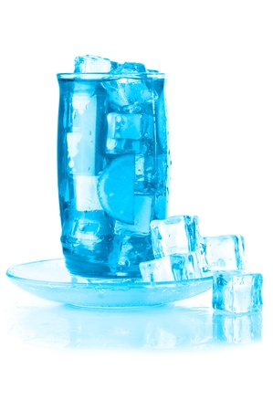 Glass of iced mineral water with ice cubes and lime, covered with water drops on white wet surface with reflection. Blue colored image Stock Photo - 9626161