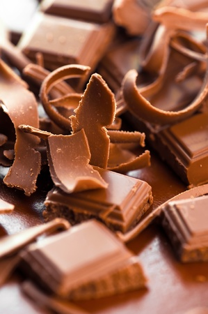 Chocolate background. Bars and strips of chocolate. Shallow depth of field photo