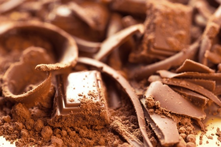 Chocolate background. Bars and strips of chocolate with cocoa powder. Shallow depth of field Stock Photo