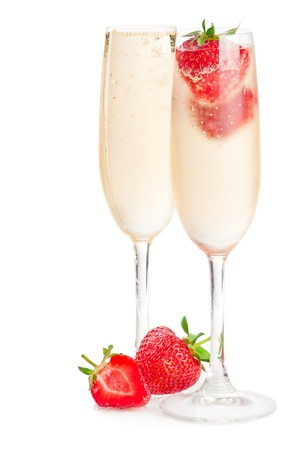 Two glasses of sparkling wine (champagne) and strawberry on white photo