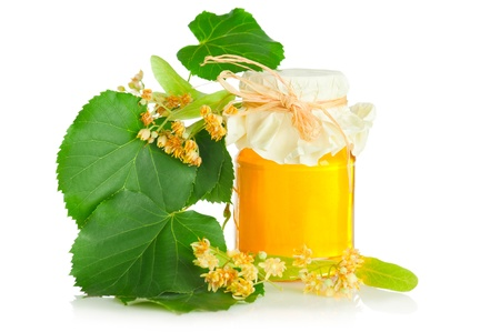 blossom honey: Fresh sweet honey and branch with flowers of linden tree on white background