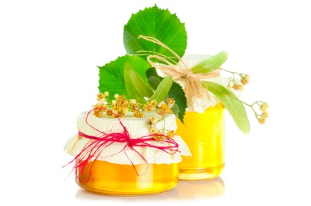 blossom honey: Fresh sweet honey and branch of linden tree with flowers on white background