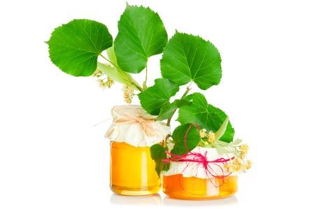 tilo: Subdivisión de Tilo con flores sobre fondo blanco y miel dulce fresco
