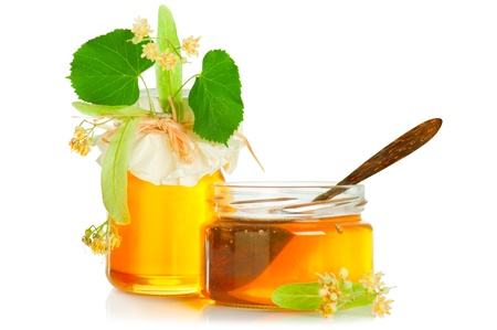 Fresh sweet honey, linden flowers and wooden spoon on white background 版權商用圖片