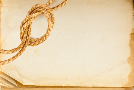 Old book page and hemp rope with space for your text